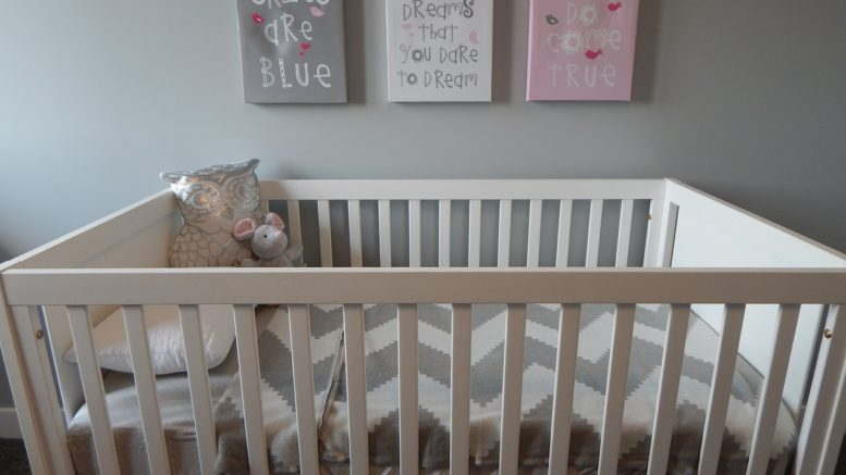 When Should a Baby Sleep in Crib in Own Room?